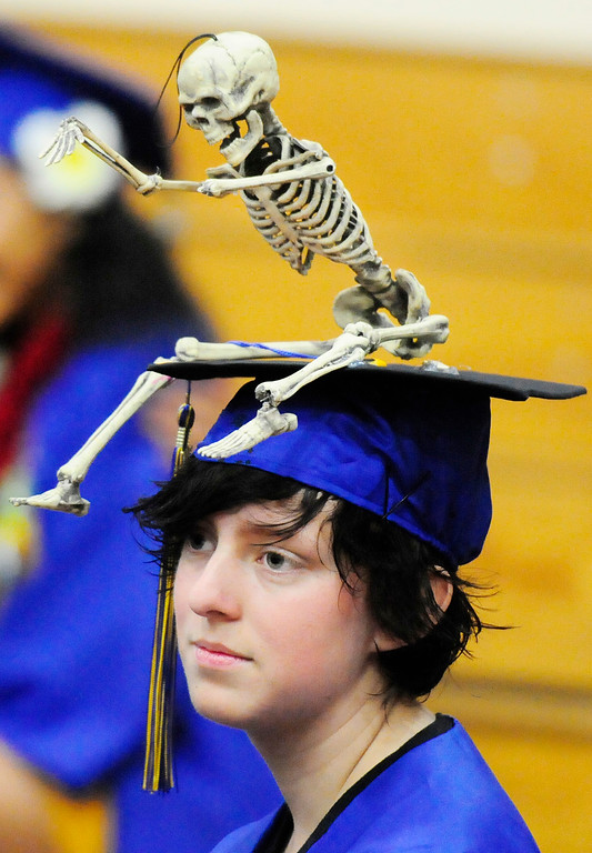 . BENICIA, CA - JUNE 9, Curtis Suro decorates his cap with a skeleton during graduation at Benicia High School on Saturday. (CHRIS RILEY/TIMES-HERALD)