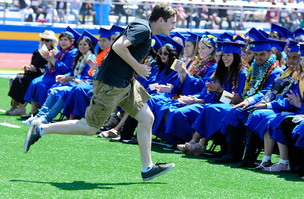". BENICIA, CA - JUNE 9, After infiltrating the ceremony in a cap and gown for the Panther TV program a student rips off his gown stating ""I\'m not graduating!\""  and runs out during graduation at Benicia High School on Saturday. (CHRIS RILEY/TIMES-HERALD)"