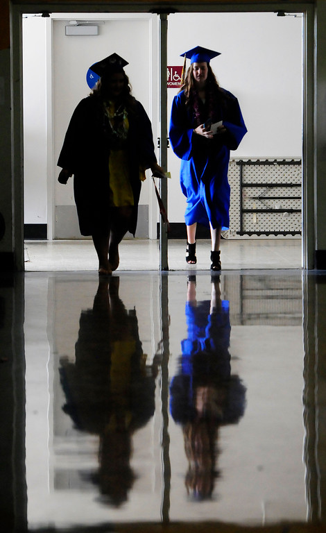 . BENICIA, CA - JUNE 9, Graduates walk into the gym before graduation at Benicia High School on Saturday. (CHRIS RILEY/TIMES-HERALD)