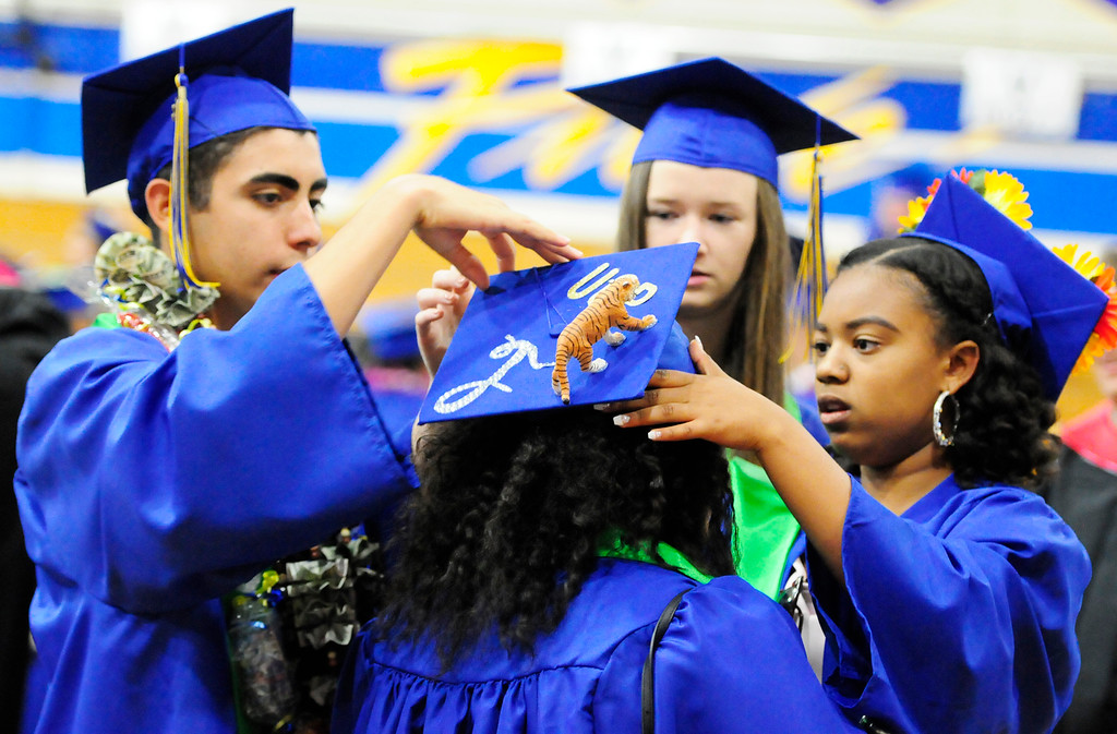 . BENICIA, CA - JUNE 9, From left, Nick Lucero, Kalin Nagle and Amaya Clark help Tia Gaskin with her cap before the graduation at Benicia High School on Saturday. (CHRIS RILEY/TIMES-HERALD)