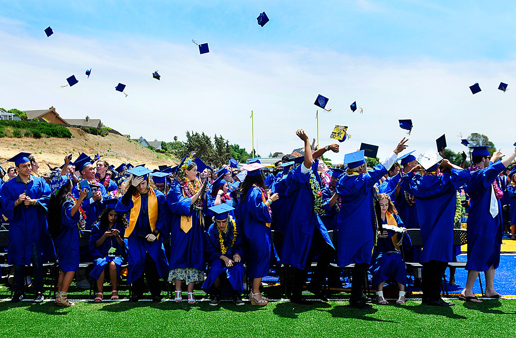 . (Chris Riley/Times-Herald) Benicia High School graduates throw their caps into the air at the end of the graduation ceremony in Benicia on Saturday.