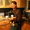 Dad calms down Benjamin in the Baby Bjorn while trying to eat dinner