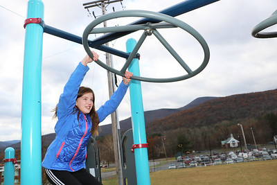 Bennett Student Council member Rachel Williams tries out the equipment on her school's new playground, which opened on November 27.