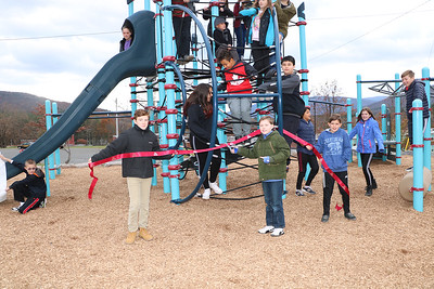 Bennett Elementary School's Student Council held a ribbon-cutting ceremony on November 27 to mark the official opening of the school's new playground. Holding the ribbon are (from left to right) Student Council Secretary Sean Hallinan, President Linus Driscoll, and Vice President Che Spiotta.