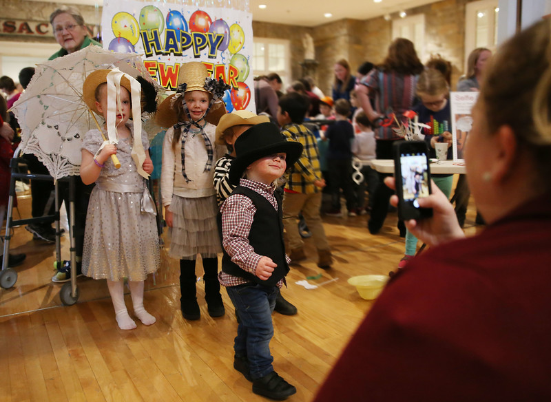 HOLLY PELCZYNSKI - BENNINGTON BANNER Jack Loveland 1 year old of Bennington poses with his sister Annalise 4 years old and her friend Basil Thurber 4 year old all dressed for New Years Eve on Monday Demeber 31st during the Noon-years eve party at the Bennington Museum.