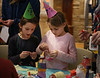 HOLLY PELCZYNSKI - BENNINGTON BANNER Elly Wilkinson and Olivia Durfour 7 years old of Williamstown make noise makers while wearing party hats during the Noon-Years eve party held at the Bennington Museum on Monday December 31st.