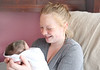 HOLLY PELCZYNSKI - BENNINGTON BANNER Gabrielle Freeman of Bennington holds her newborn baby Taylor Ann Woodard on Wednesday afternoon at the maternity ward of the Southwestern Vermont Medical Center in Bennington. Taylor Ann was born on New years Day at 2:52 Pm weighing 5 lbs and 15 oz.16.75 inches long.  She was born on her mother's birthday surprisingly in the same that her mother was born in 22 years prior. Her mother, Gabrielle Freeman was also the first baby born in the state of Vermont 22 years ago.