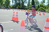 David LaChance — Bennington Banner<br /> Charlotte Burnham, 4, of Bennington, concentrates as she rides the road course.