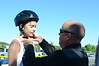 David LaChance — Bennington Banner<br /> Cass Coulter, 10, of North Bennington, gets his new helmet fitted by Police Chief Paul Doucette. Members of the Bennington Police Association make sure that every helmet given out was correctly fitted.
