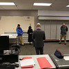 HOLLY PELCZYNSKI - BENNINGTON BANNER Mike Carey, Senior Vice President of sales for Tranzon Auction Properties starts the bidding between Peoples Bank in Bennington and two bidders, Mark O'Connor and Evan Portno.