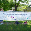 HOLLY PELCZYNSKI - BENNINGTON BANNER Support Staff members at Molly Stark School in Bennington Mrs. Ridley and Ms. Garcia hang a sign before runners pass by the school during the Law Enforcement Torch Run for the special olympics on Wednesday morning.