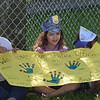 HOLLY PELCZYNSKI - BENNINGTON BANNER Savianna Bushee, Kindergartner at Molly Stark holds a sign in support of law enforcement running in the Law Enforcement Torch Run for the special olympics on Wednesday morning.