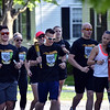 HOLLY PELCZYNSKI - BENNINGTON BANNER Members of the Bennington Police Department, Sheriffs Department and voluntary participants run down Monument Ave in Bennington on Wednesday morning during the Law Enforcement Torch Run for the special olympics.