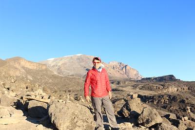 2016-09-27 Benson Tanzania Africa (Tue) Kilimanjaro Day 03 Moir Camp - Bob at the ridge top with Mt Kilimanjaro (Kibo peak)in background