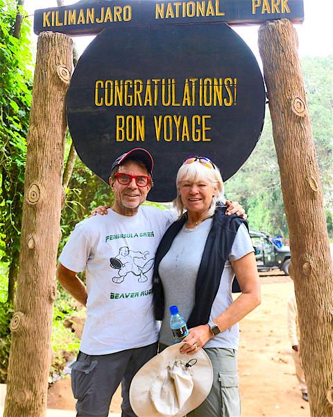 2016-10-02 Benson Tanzania Africa (Sun) Kilimanjaro Hike out - Bob Jo at Congratulations Exit Sign