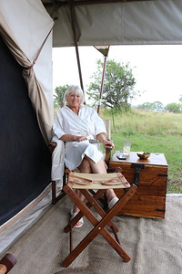 2016-10-07 Benson Tanzania Africa (Fri) Safari Day 13 Serengeti Under Canvas - Jo Benson in front of tent in robe