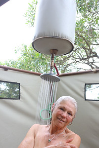 2016-10-07 Benson Tanzania Africa (Fri) Safari Day 13 Serengeti Under Canvas - Jo Benson in shower 01