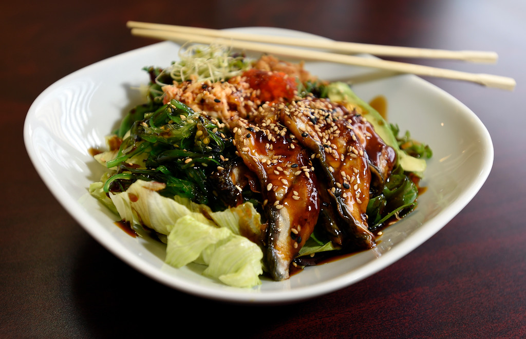 . The Eel Poke Bowl with lettuce, kale, spring mix, Avacado with sweet sauce, Eel, seaweed salad, masago, crab salad, onion crunch, at Bento-Ria Sushi on University Hill on Monday in Boulder. For more photos of the food at Bento-Ria Sushi go to www.dailycamera.com Jeremy Papasso/ Staff Photographer/ April 17, 2017