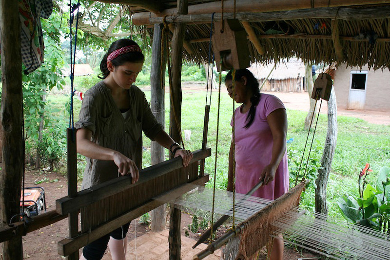 Andria weaving with our host mom in Santa Rita