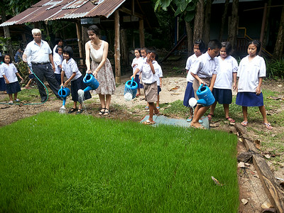 Watering the young rice before planting at Pah Tdao Pattana School  Photo by Panisara Techanan