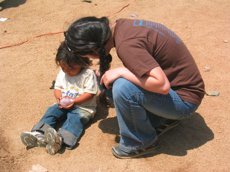 2004 05 30 Sunday Green Team - Michelle Gunari comforts crying girl