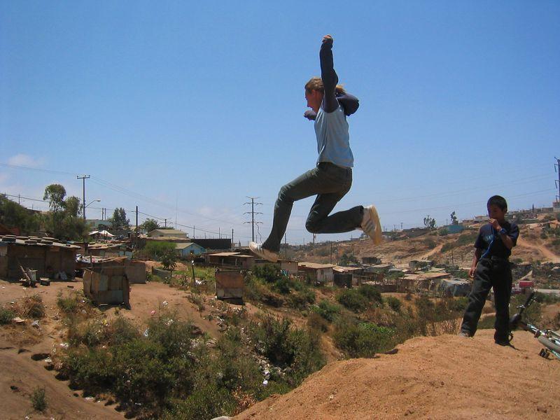 2004 05 30 Sunday Green Team - Cliff jumper Katie Howard in flight
