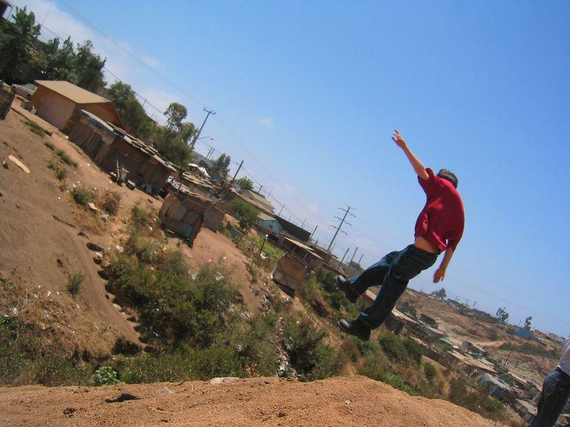 2004 05 30 Sunday Green Team - Cliff jumper Spencer Tuma comes in for landing