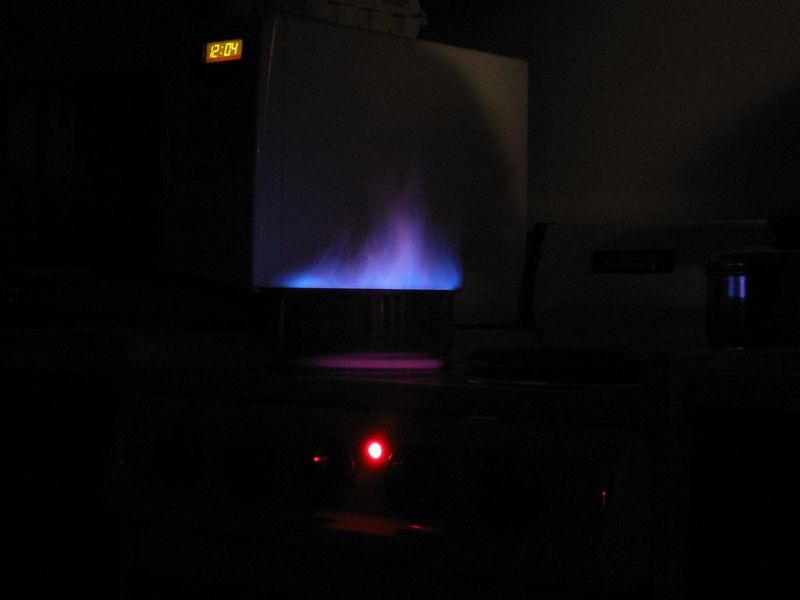 2004 08 23 Monday - Rhonda's 23rd birthday - long shutter flaming peaches blue flame @ Rhonda, Lisa, & Teresa's apt