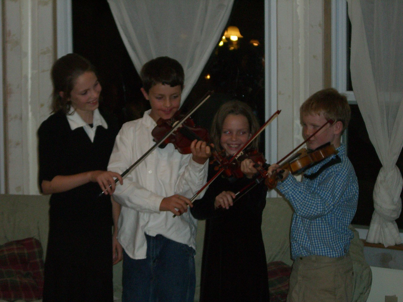 Sarah, Spencer, & Sterling Tuma and James Clifford sharing violins