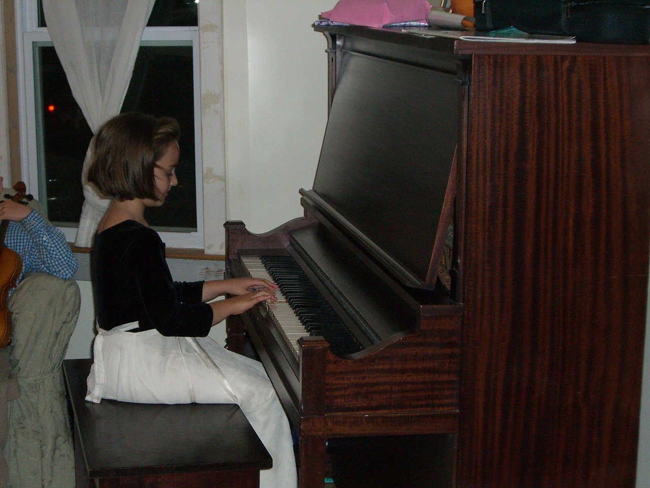 Birthday Girl Savannah Tuma on piano