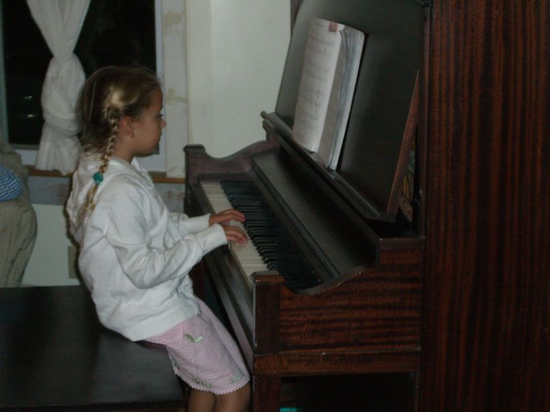 Family friend pastor-kid at the piano