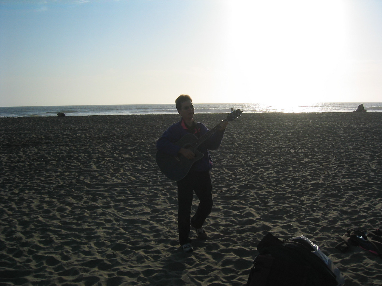Chris roams the beach serenading