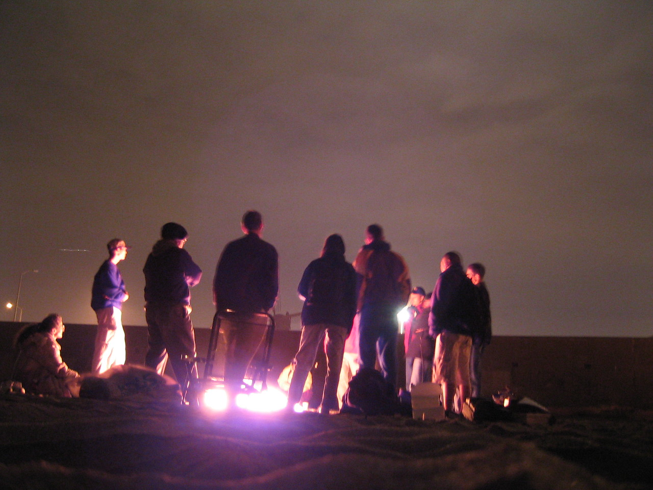 Saying so around fire - Group back overexposed