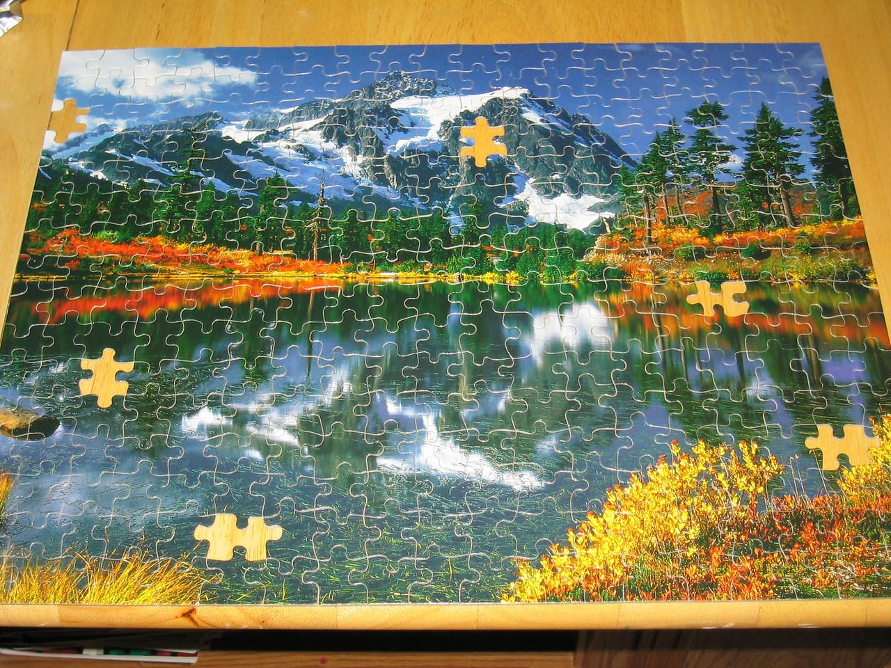 Albert & Lisa's community group - Puzzle fitting success minus half a dozen pieces missing by half a dozen people in about half a dozen 10 minutes, Tuesday 2003 07 22