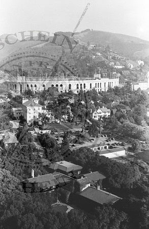 UC Stadium with empty hils behind, campus buildings in foreground