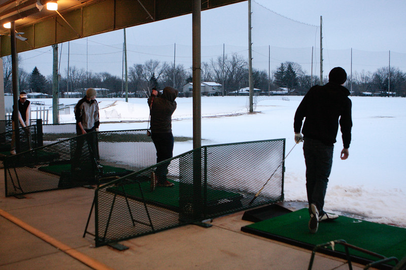 (Thursday March 13th 2014 - Royal Oak Golf Center, Royal Oak, MI) Berkley High's golf team practices at the Royal Oak golf center onto still snow covered driving range. Photo by: Brian B. Sevald