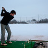 (Thursday March 13th 2014 - Royal Oak Golf Center, Royal Oak, MI) Berkley High's Donny Karle takes a swing at practice at the Royal Oak golf center onto still snow covered driving range. Photo by: Brian B. Sevald