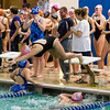 Emily Molino (far right) cheers on her teammate Lauren Kinne, who is just leaving the blocks as Maridith Jordan touches the wall.