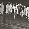 Tanglewood, Aug. 12, 1937. Festival goers try to avoid puddles following torrential rains. Rain over this weekend led to funds being raised for The Shed.