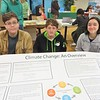 Simon's Rock Academy students are currently taking a class on climate change. Here, from left, Remy Bahr, Grayson Ball and Estela Quinones, share a poster they created on the subject during the April 6 Berkshire Earth Expo held in Pittsfield at the Boys & Girls Club of the Berkshires. JENN SMITH — THE BERKSHIRE EAGLE