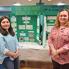 Taconic High School sophomores Gianna Arace, left, and Cloey Parlapiano, listed plastics pollution and global warming among their top environmental concerns for the future. Arace shared her project on compostable utensils while Parlapiano displayed her research on reef-safe sunscreen during the April 6, Berkshire Earth Expo held at the Boys and Girls Club of the Berkshires in Pittsfield. JENN SMITH — THE BERKSHIRE EAGLE