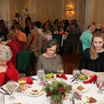 Guests prayed prior to the Christmas luncheon.