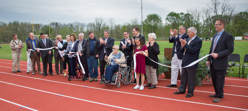 . Kutztown celebrates grand opening of new stadium on May 6, 2018. Kutztown School Board members, Kutztown Education Foundation representatives, administrators, and State Rep. Gary Day applaud the ribbon cutting. Helen Breidegam was given the honor to cut the ribbon, officially dedicating the stadium. Photos by Dennis Krumanocker