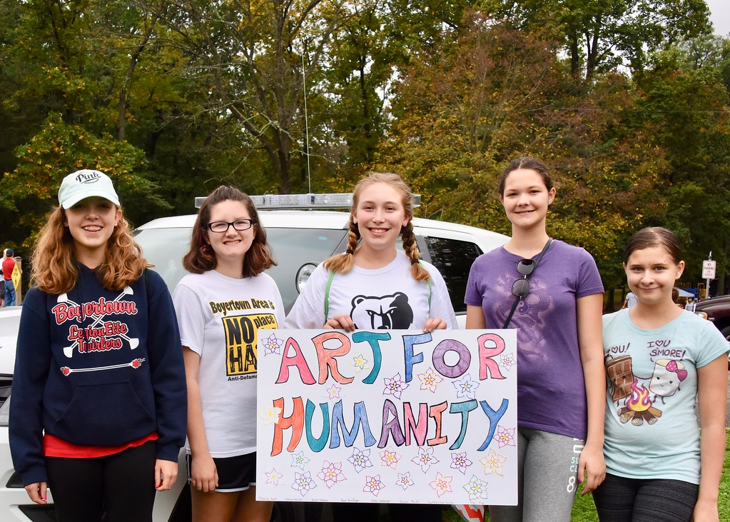 . Art for Humanity club members Melaina Kett, Haley Weinberger, Madison Hoelzle, Catherine Sarte, and Seysha Marks attend the Unity Walk for the first time.