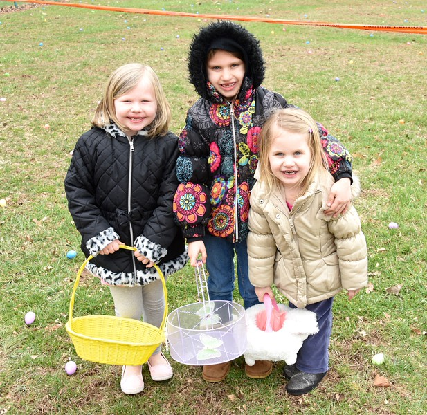 Six-year-old Alex Klunk, 6-year-old Madison Eidle and 3-year-old Natalie Eidle at the egg hunt.