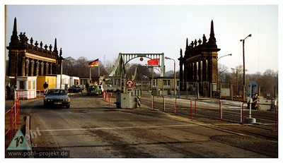 An oldr photo of the Glienicke Brücke (bridge) which spans the border between Berlin and Postdam. At the time, the border between West Berlin and East Germany ran directly across the center of the bridge. It was heavily fortified and guarded on the East German side, and was the location of many prisoner exchanges between East and West during the Cold War
