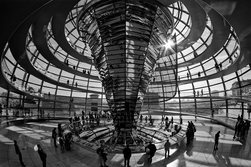 Visitors flocking through the backlit Reichstag dome (b/w)
