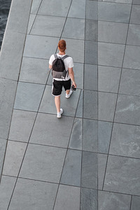 A photographer walking near the German Chancellery in Berlin