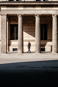 A woman walking in museum island Berlin