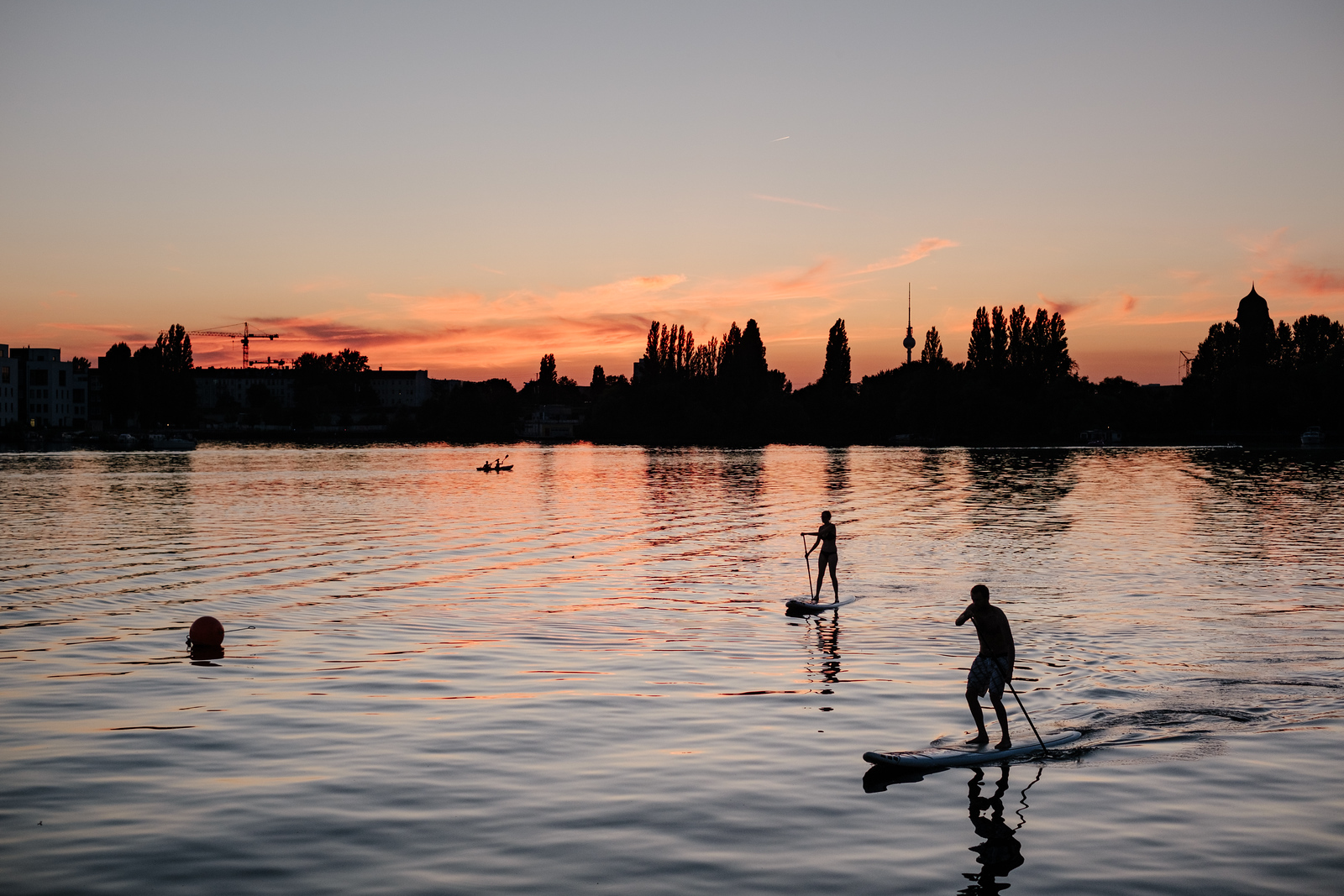 Paddle boarding on a lake in Berlin